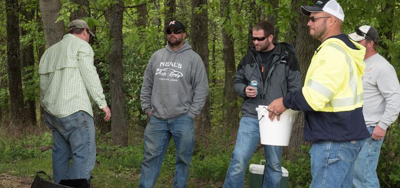 group of men speaking
